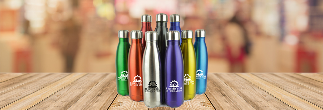 Nine coloured metal water bottles on a wooden table